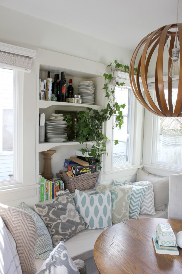 The Grit and Polish Cozy Dining Nook with Pillows and West Elm Light.jpg