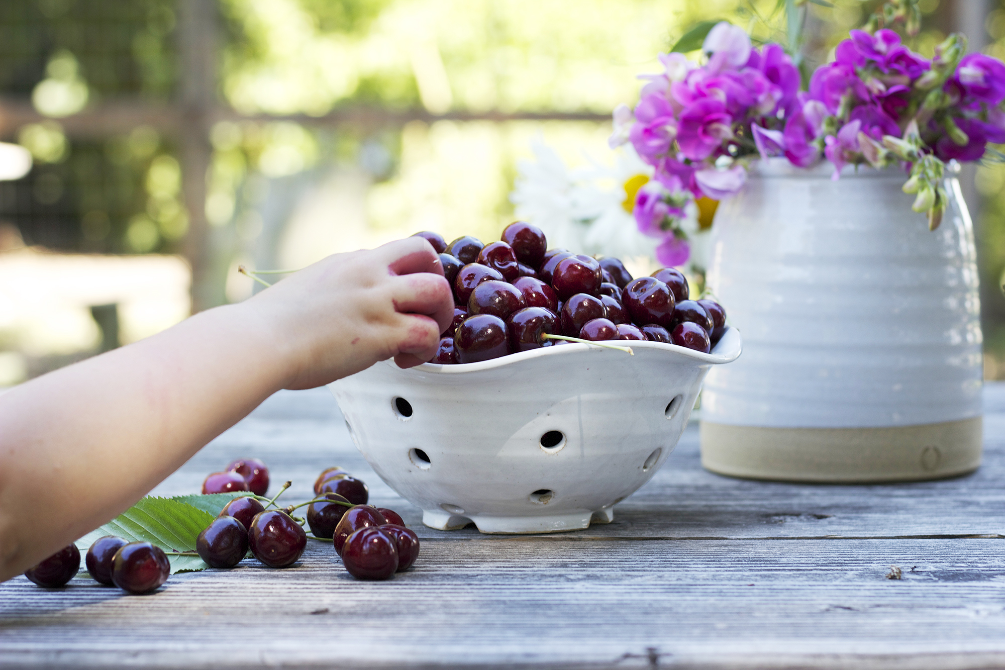 The-Grit-and-Polish-Farmhouse-Cherries-and-Hand.jpg