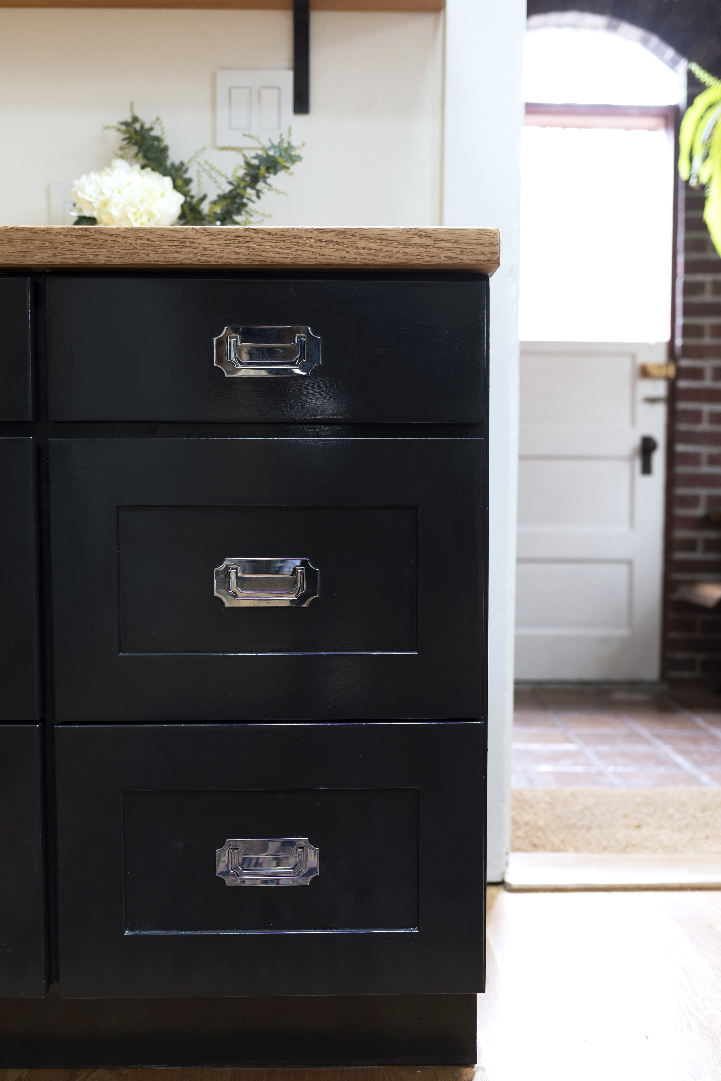 The Grit and Polish - Dexter Kitchen black Cabinets repainted.jpg