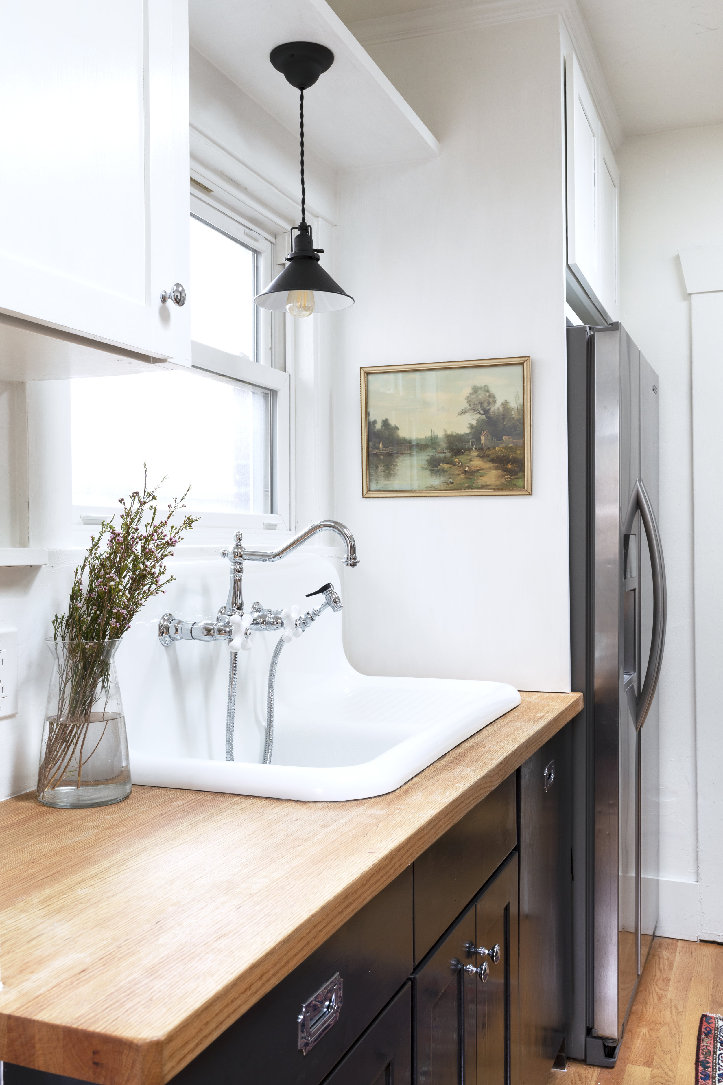 Replica Vintage Sink and vintage landscape art at the Dexter House Kitchen // the Grit and Polish