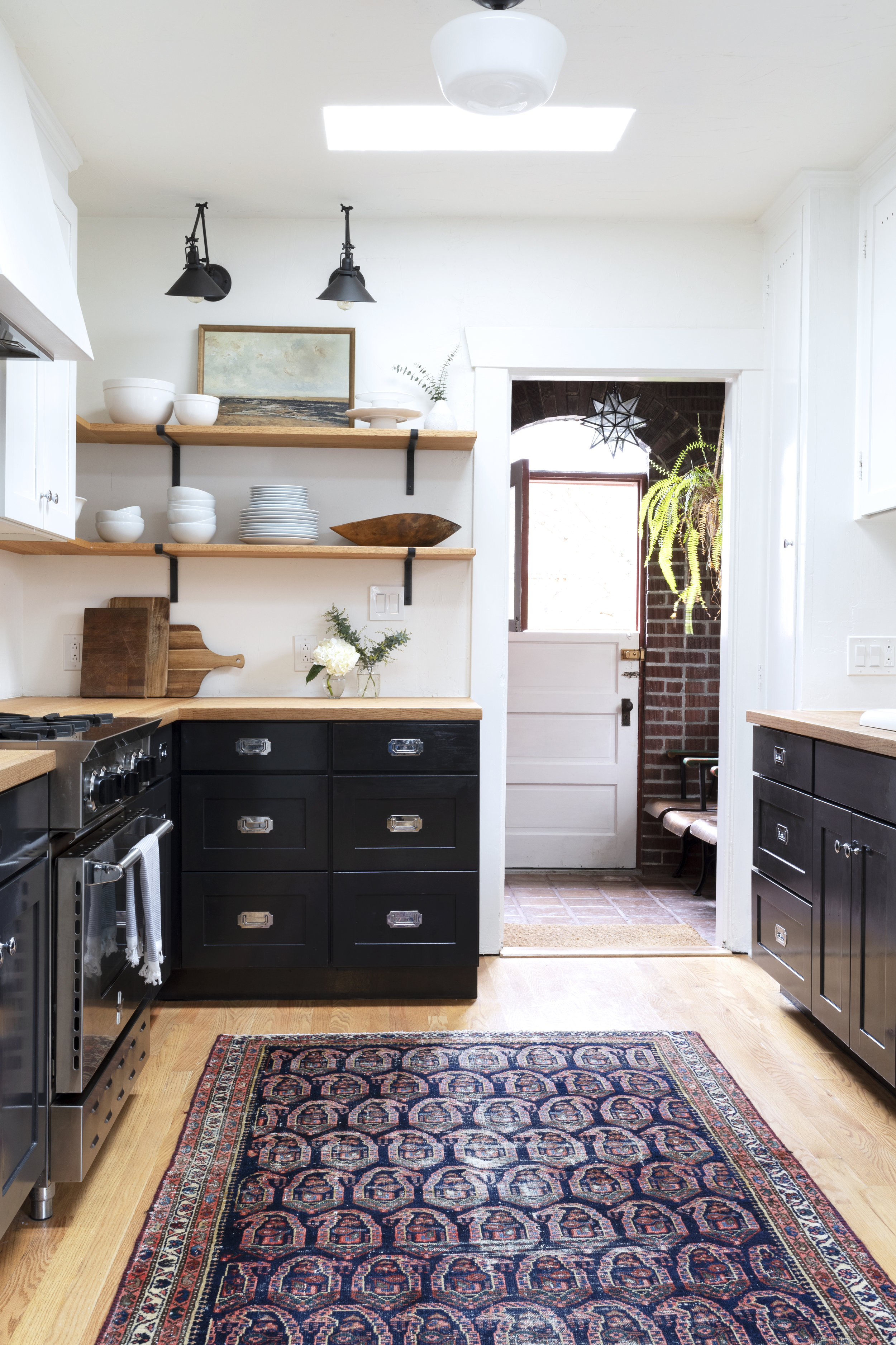 The Grit and Polish - Dexter Black, White, and Wood Kitchen.jpg