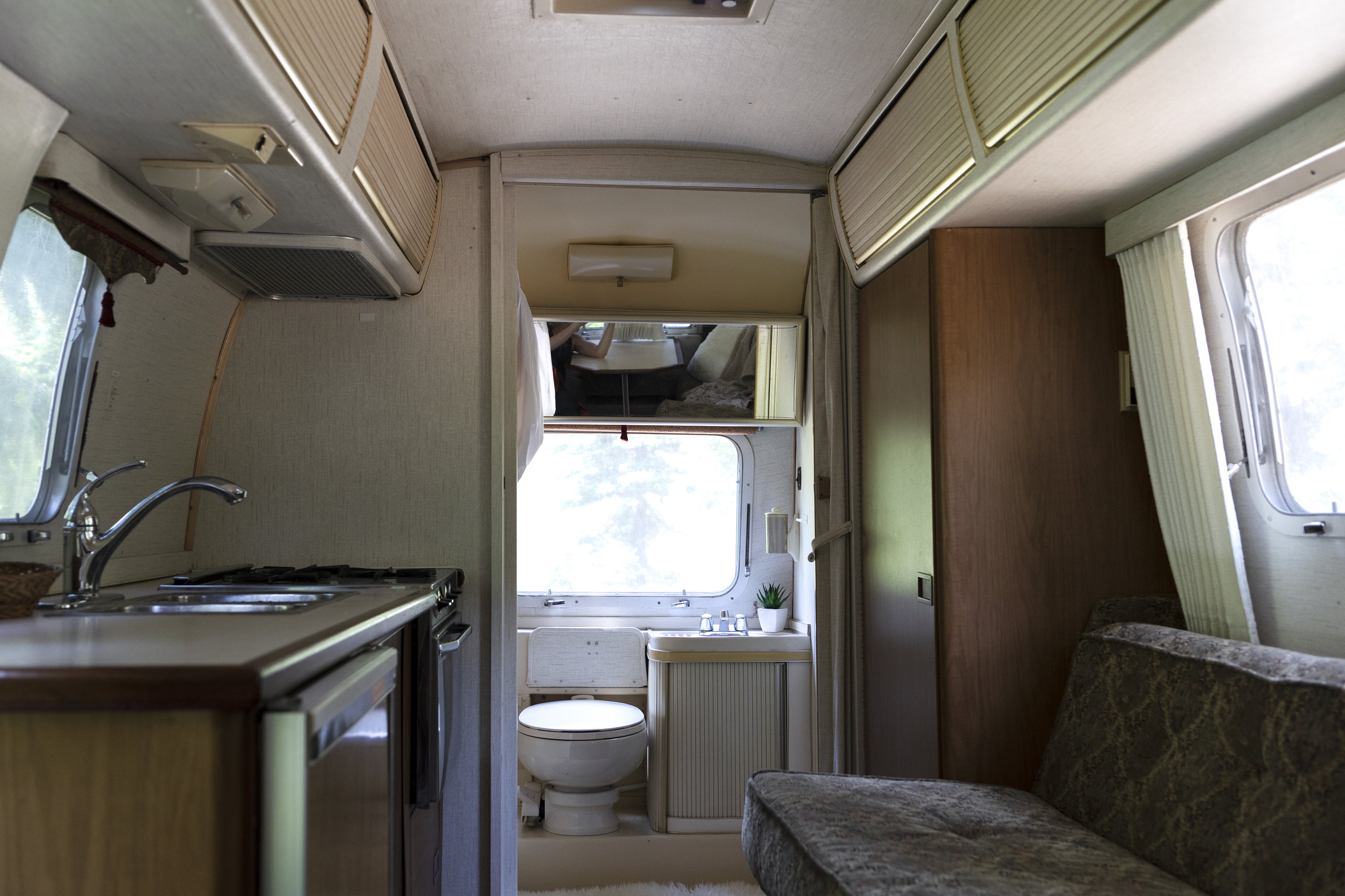 The Grit and Polish - Airstream Argosy Kitchen to Bathroom.jpg