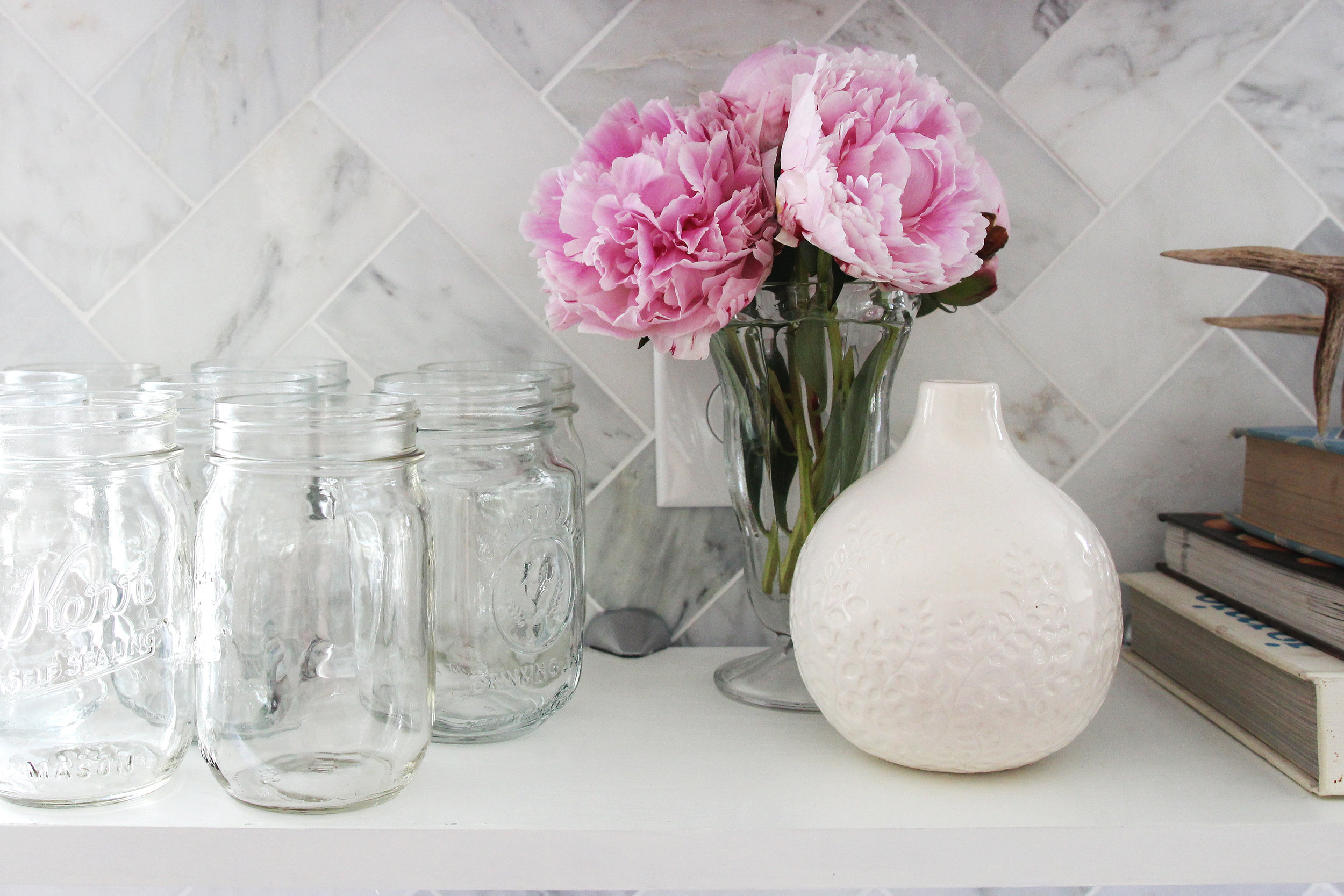 Kitchen Open Shelves Glasses and Flowers and Vase