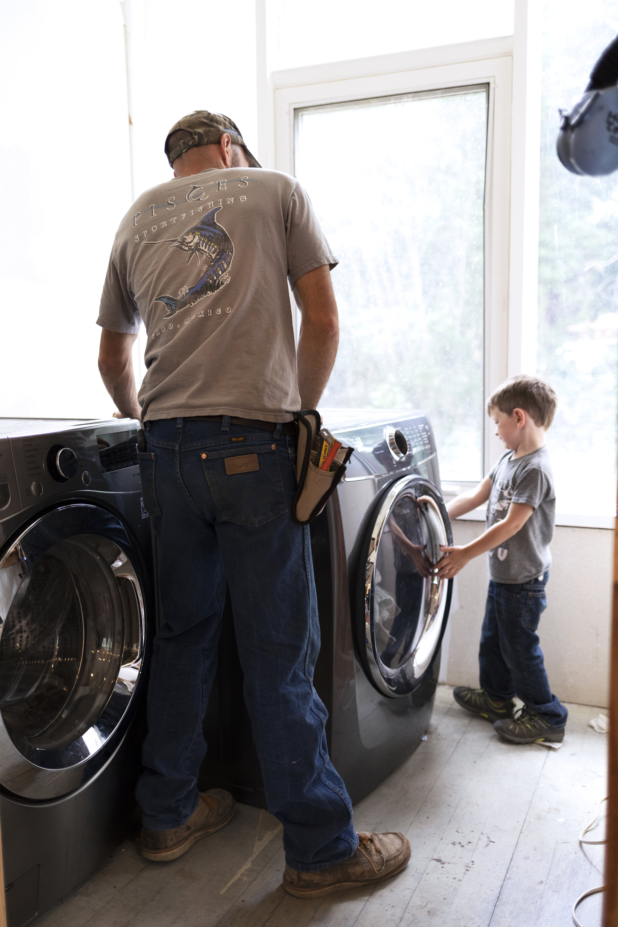 The Grit and Polish - Farmhouse Laundry Room Moving Machines.jpg