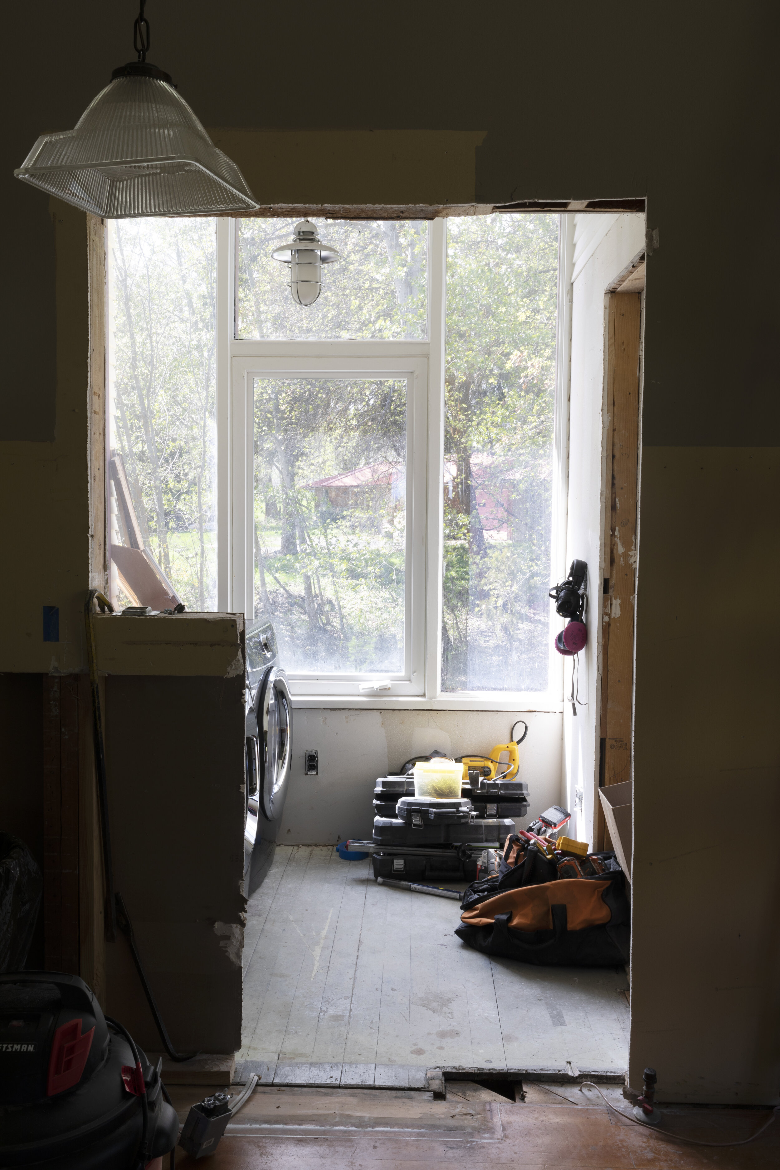 The Grit and Polish - Farmhouse Laundry Room Windows Before.jpg