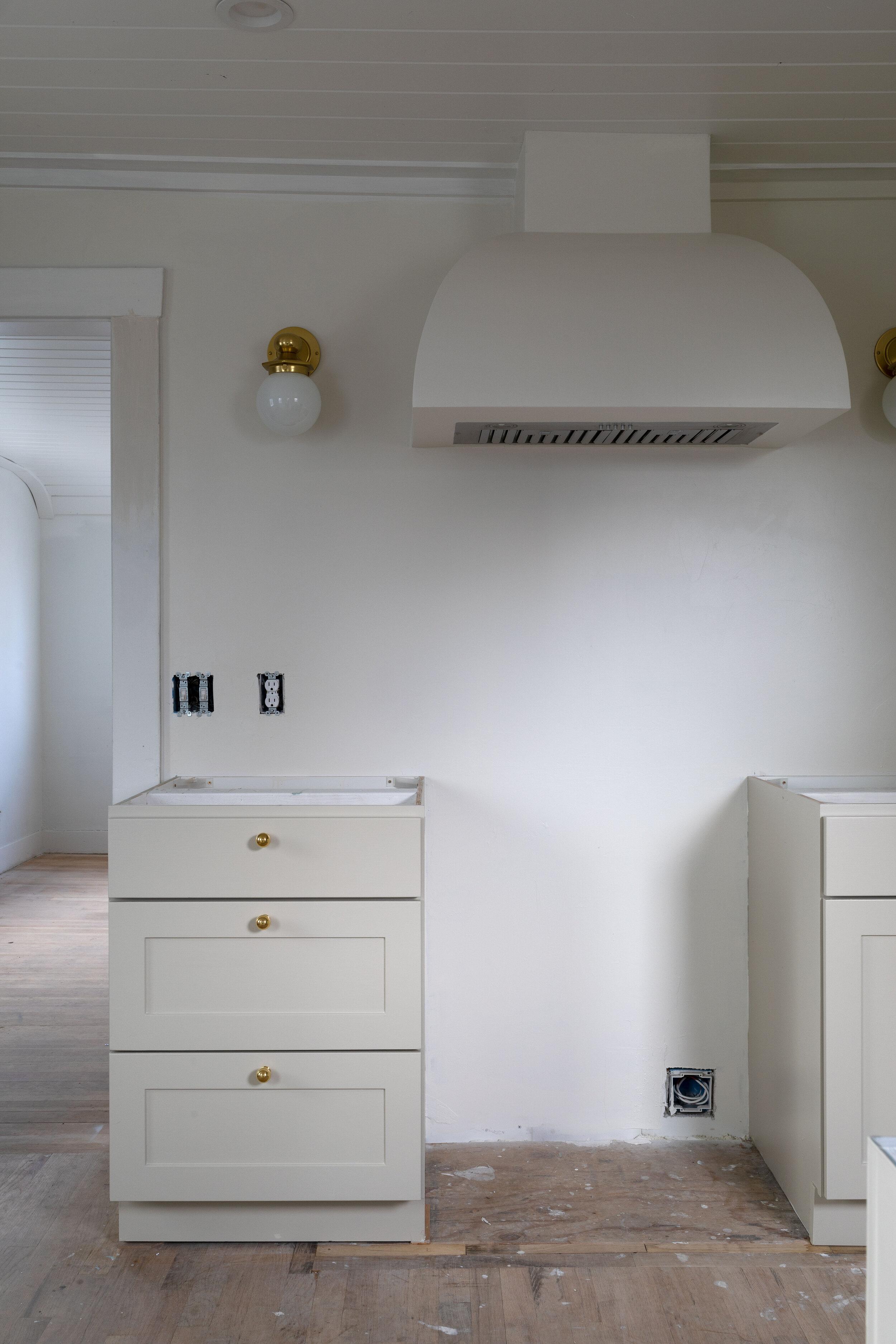 how we customized basic stock cabinets for the Poplar Cottage kitchen on www.thegritandpolish.com