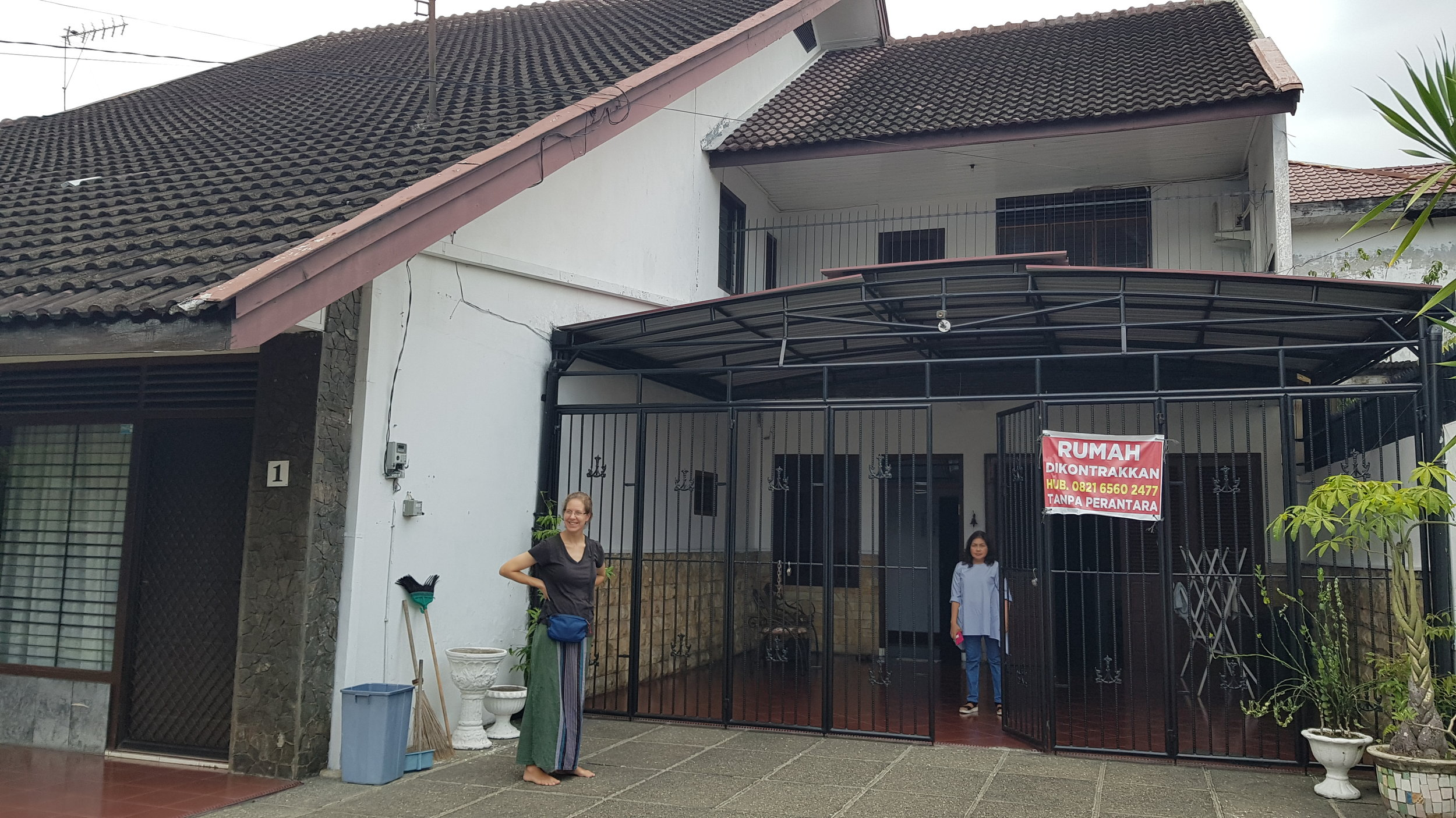 This is our home in Medan. Pictured on the right is Cheryl Ferry who lived here previously. Behind the gate is Ibu (Mrs.) Nana our land lord.
