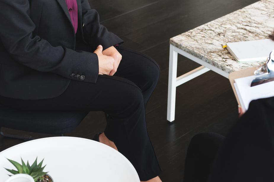 business-woman-sits-for-job-interview_925x.jpg