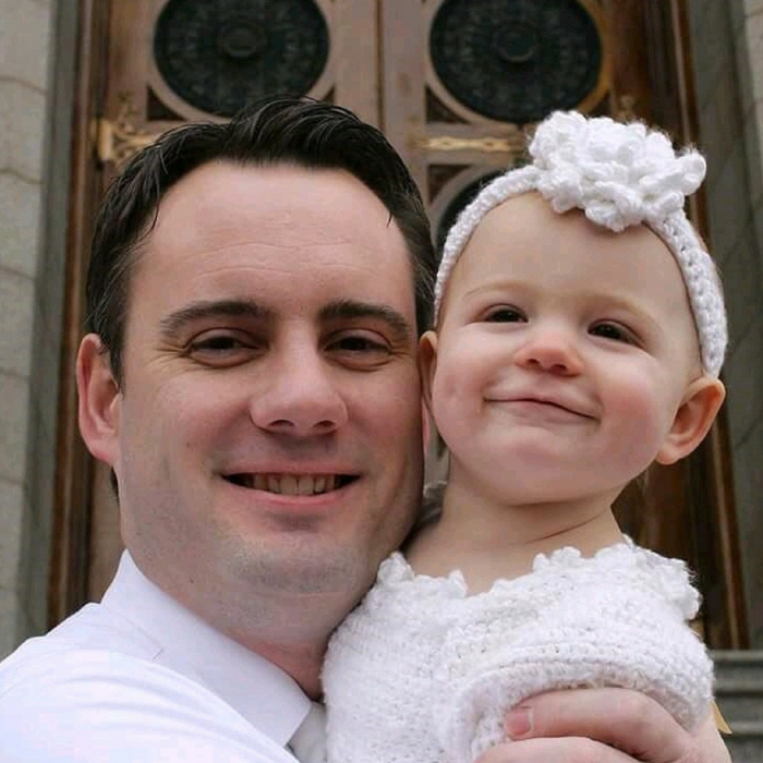 a46de095744b8f7ed1cef25700b57b48ca7fea6f_husband-and-baby-smiling.png