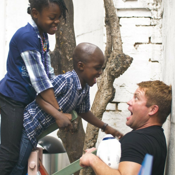 666a322e3c087eff38b5cb2bb8ebcd11b391a1fd_tim-at-orphanage-with-colin-and-coline.png
