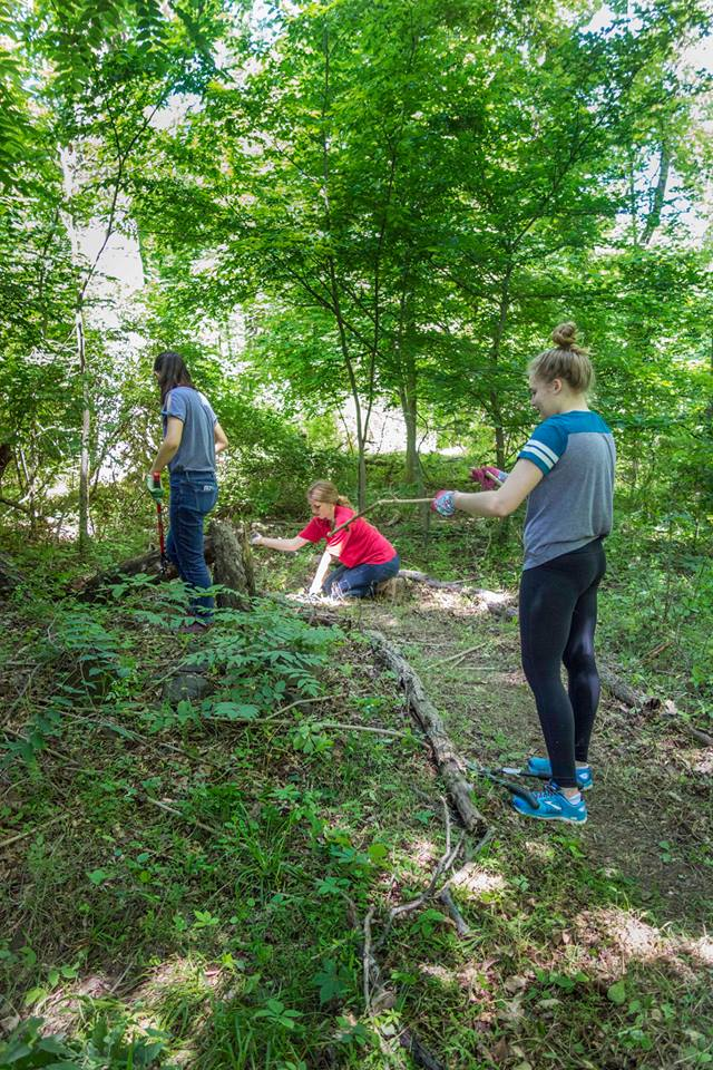 Volunteers creating a hiking trail at Zion Crossing preserve.
