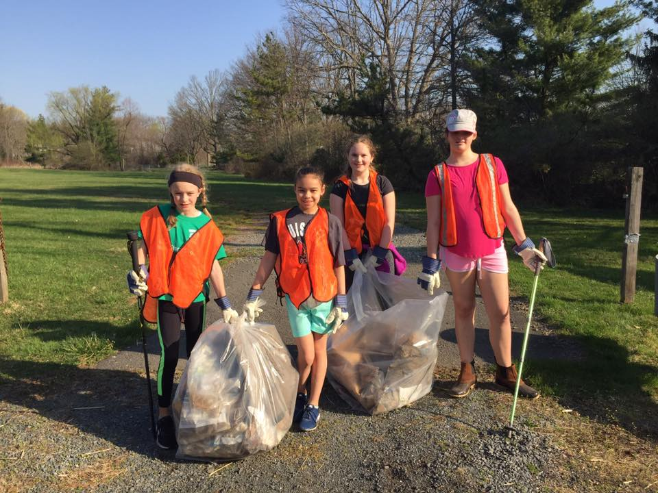Volunteers cleaning up trash on preserves.