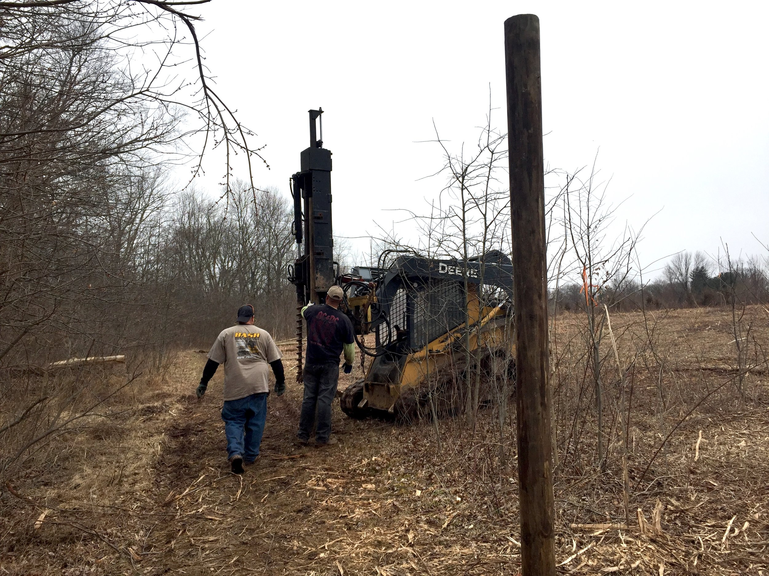 The Foraging Forest was mowed with a Timberax and contractors are starting the installation of a deer exclosure fence.