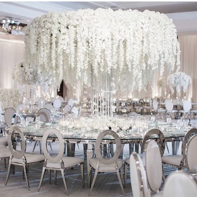 There's something about an all white theme that exudes boldness and elegance! What are your thoughts on these larger than life centerpieces? #weddingcenterpieces #weddingdecor #weddinginspiration