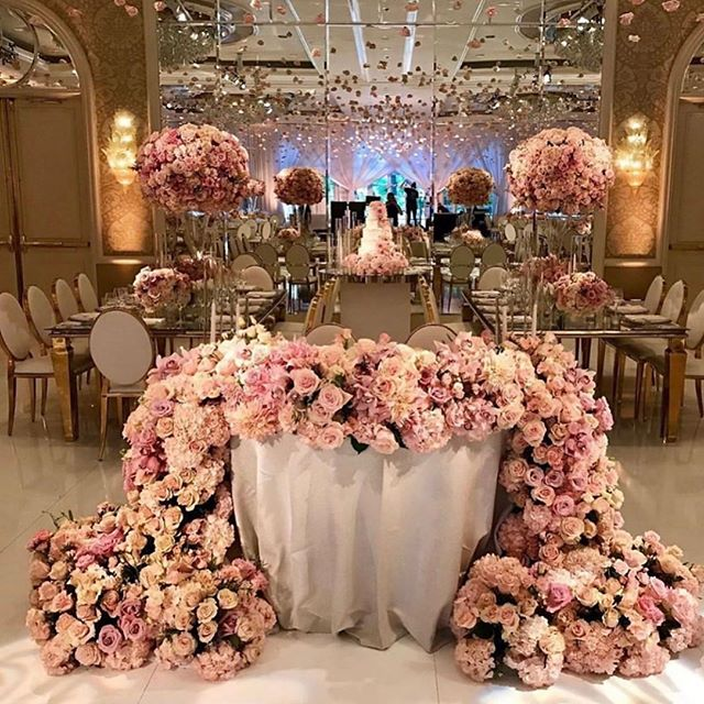 What girl doesn't love a room full of pink/blush roses? Repost from @internationaleventco • • • • • • • • #bridalinspiration #weddingdecor #weddingdecorinspiration #floralcenterpieces #weddinginspo #tallcenterpieces