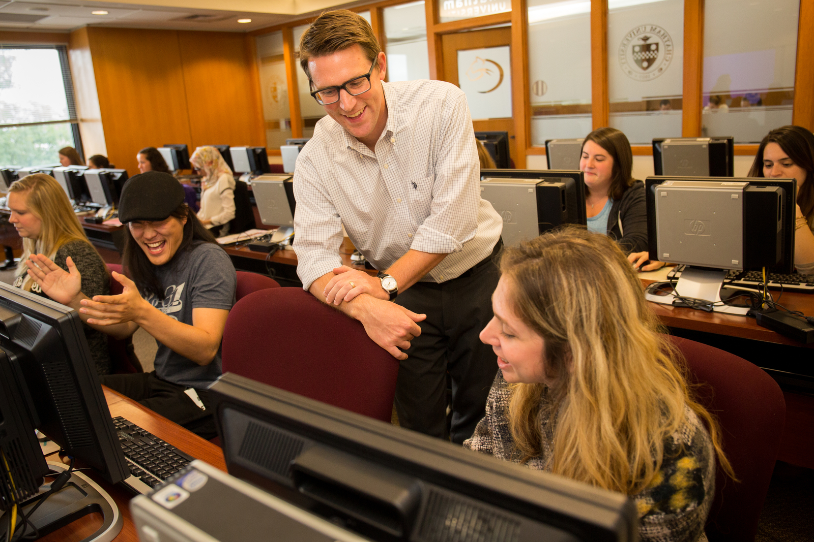Dr. Anthony Isacco , associate professor of counseling psychology, shares a laugh with his graduate students. (2015)