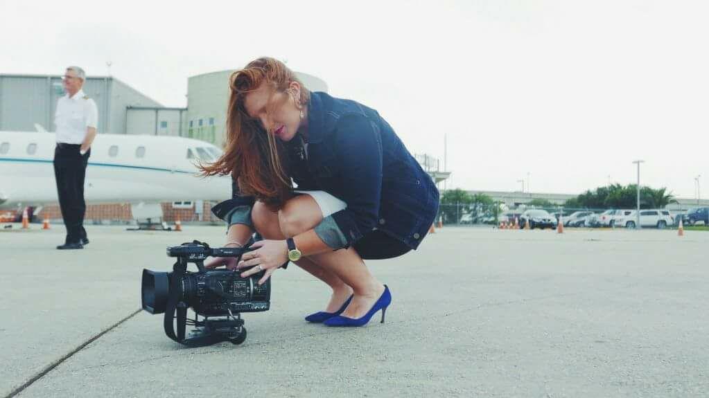 Alese Underwood, San Antonio News Reporter with video camera, Chatham University Alumna