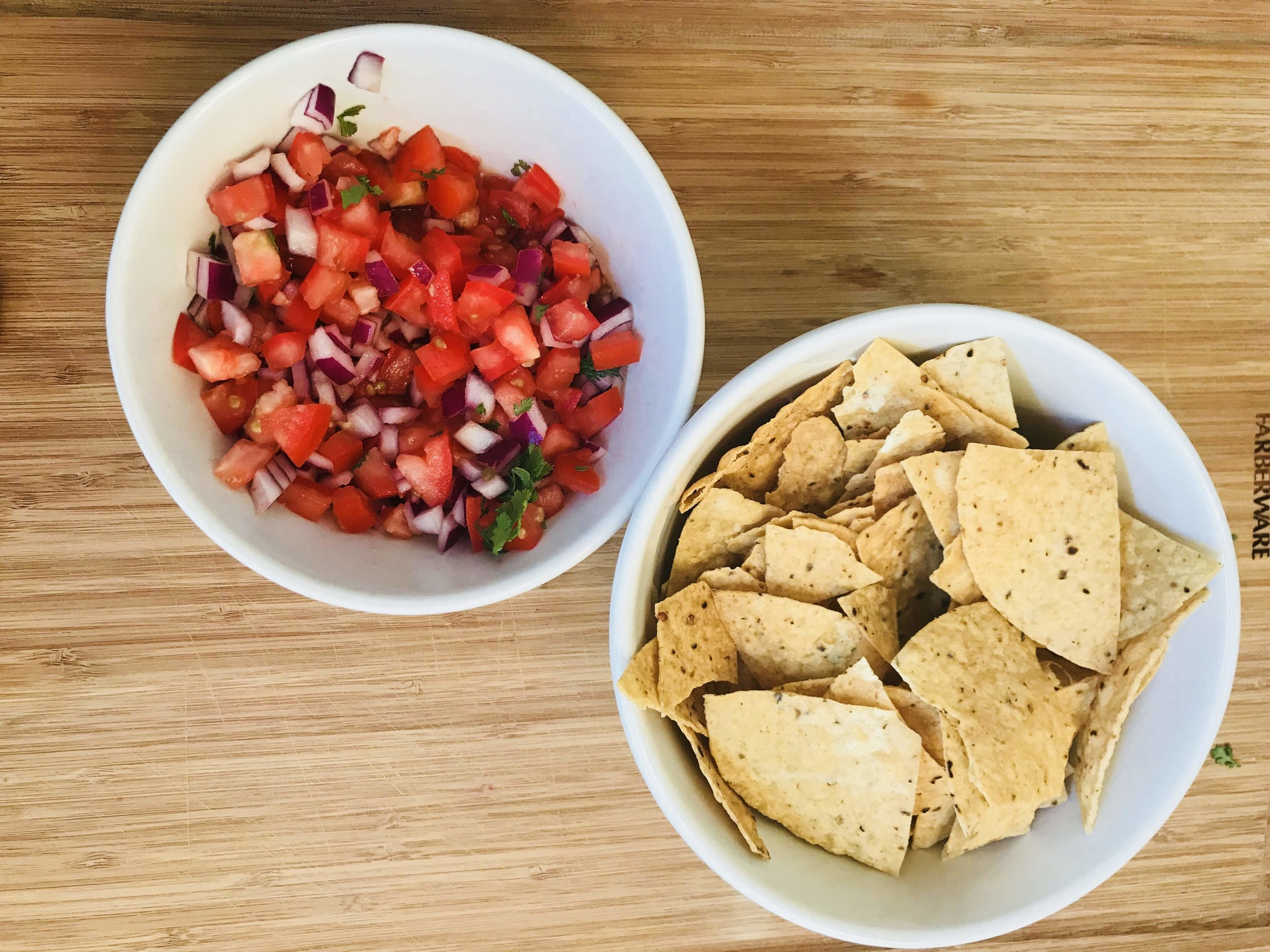 Pico de Gallo served with chips is a tasty appetizer for entertaining guests.