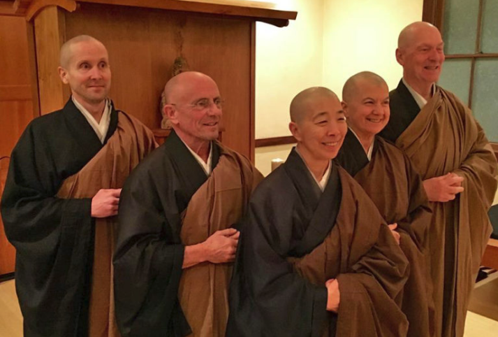 In 2018, the temple moved to a shared teaching model. Current teachers are, from left, Kokyo Henkel, Gene Bush, Dana Takagi, Cathy Toldi, and Patrick Teverbaugh. This picture was taken after the 2015 dharma transmission ceremony of Dana Takagi and Cathy Toldi, who received transmission from Gene Bush and Patrick Teverbaugh, respectively.