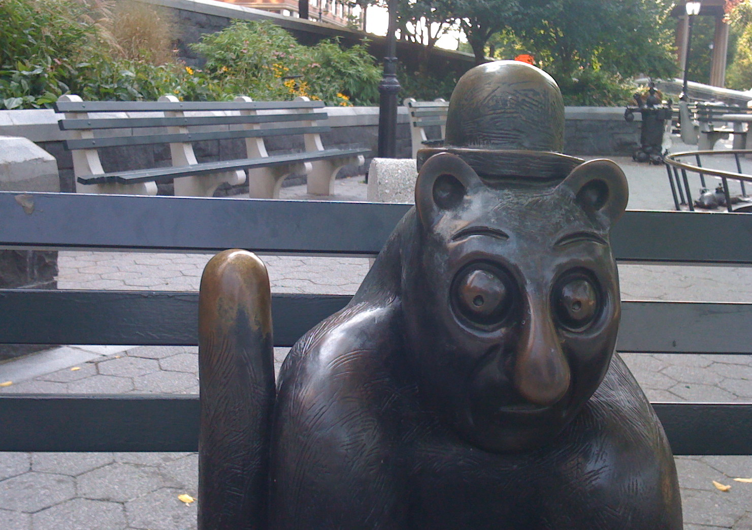 Photo, D. Takagi. Public Art, Battery Park City, Tom Otterness'. THE REAL WORLD is a fanciful world—whimsical figures of people and animals doing ordinary things.