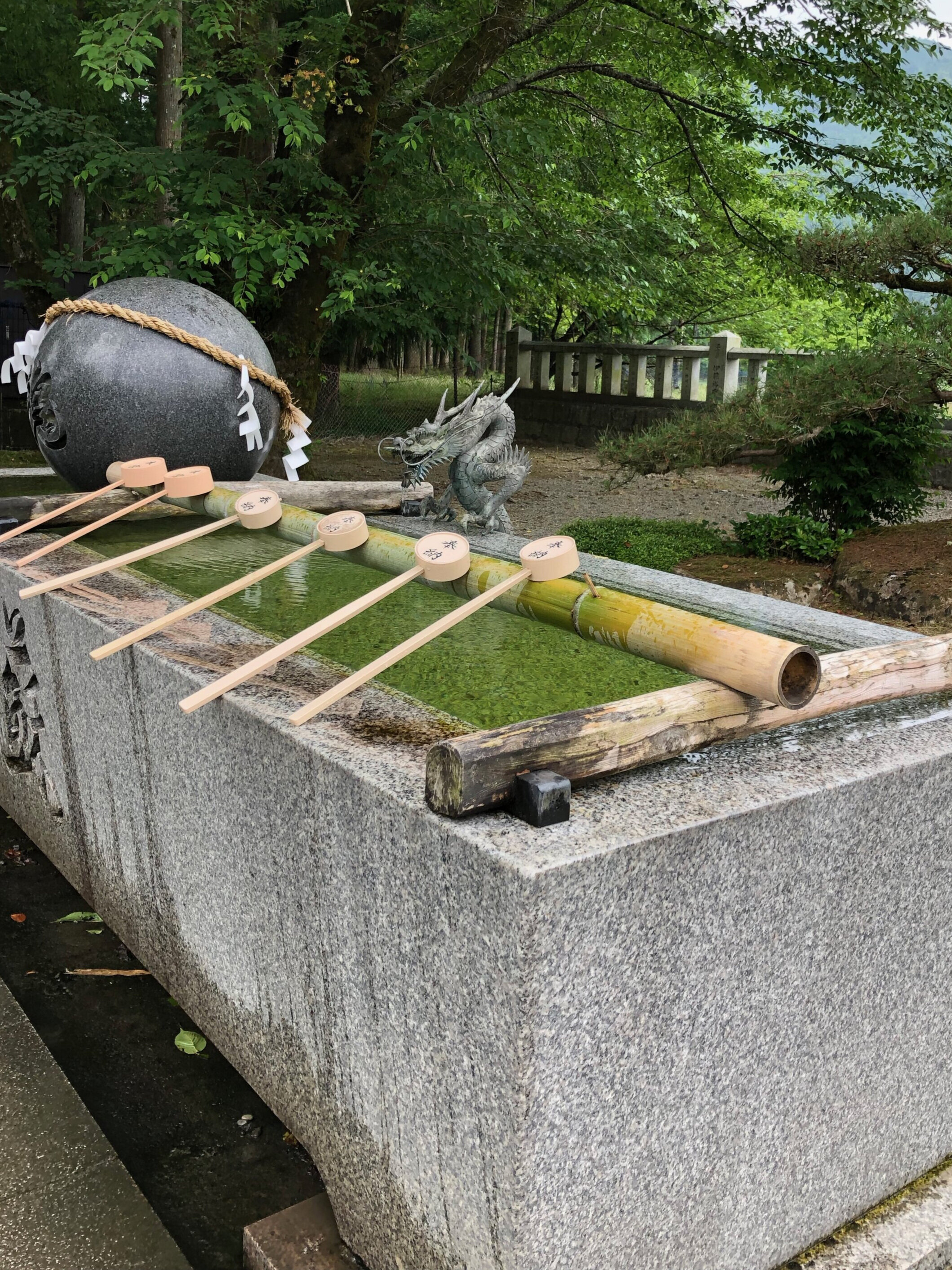 Temizu—bow first, then using the scoop, pour water over the left hand, then, right, and finally water to the mouth. Make sure the waste water falls in the trough below. Purification before entering…do this  every  time you enter. Purification demands repetition. It is never finished.