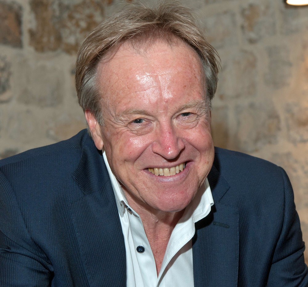 Patrick Lindsay AM   Author, broadcaster and documentary maker, Patrick has been a passionate advocate of the story of Kokoda since he first visited in 1983 and first walked the Track in 1992. He wrote the best-selling book  The Spirit of Kokoda  in 2002. He has since written 20 best sellers including  The Spirit of The Digger ;  Back From The Dead ;  The Essence of Kokoda ;  The Spirit of Gallipoli ;  Cosgrove, Portrait of a Leader ;  Fromelles ;  Our Darkest Day ;  Kokoda Spirit ;  The Coast Watchers;   True Blue;  and his  It's Never Too Late  series of motivational books. He created the format for the top-rating TV reality series,  In Their Footsteps , and, most recently, created the Kokoda App to bring the story to the digital generation. He is currently working on a feature documentary,  Kokoda … the spirit lives,  due for completion in 2017 to commemorate the 75th anniversary of the Kokoda campaign. In 2015 Patrick was named a Member of the Order of Australia for  'significant service to the media as a television presenter and journalist, to international relations, and to literature as an author' . Patrick was the Chair of KTF between 2006 – 2017.