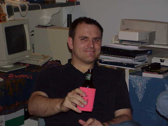 Greg and a beer in a stubby holder.JPG