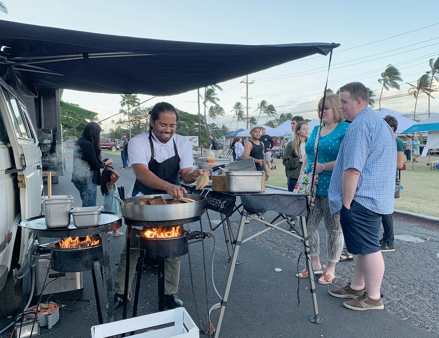 Tight Tacos owner Reggie Ballesteros prepares his Mexican dishes with Hawaiian flavors during the Maui Street Market held at the UH Maui College on Dec. 6.