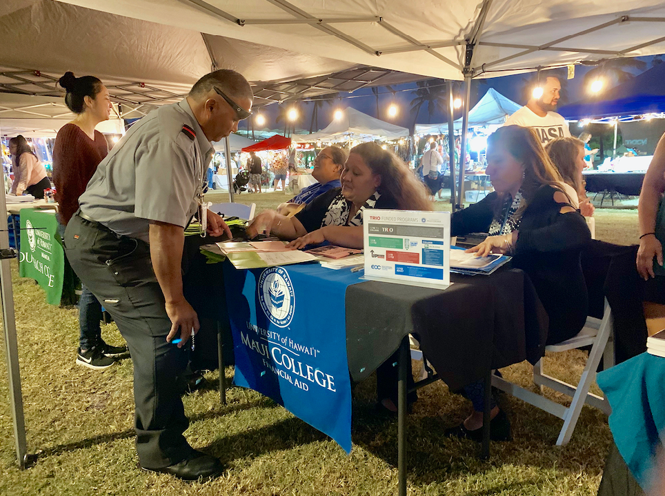 """Cliff Amalato took advantage of the Maui Street Market's UH Maui College offerings. """"There was one class I was interested in taking at the college, but it was difficult to sign up for it since I work long hours at the airport. This event enabled me to talk with the Admissions staff and get my paperwork in order."""""""