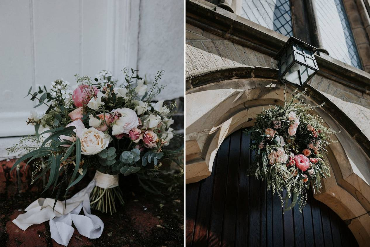 Spring pastel bridal bouquet and flower wreath on church entrance