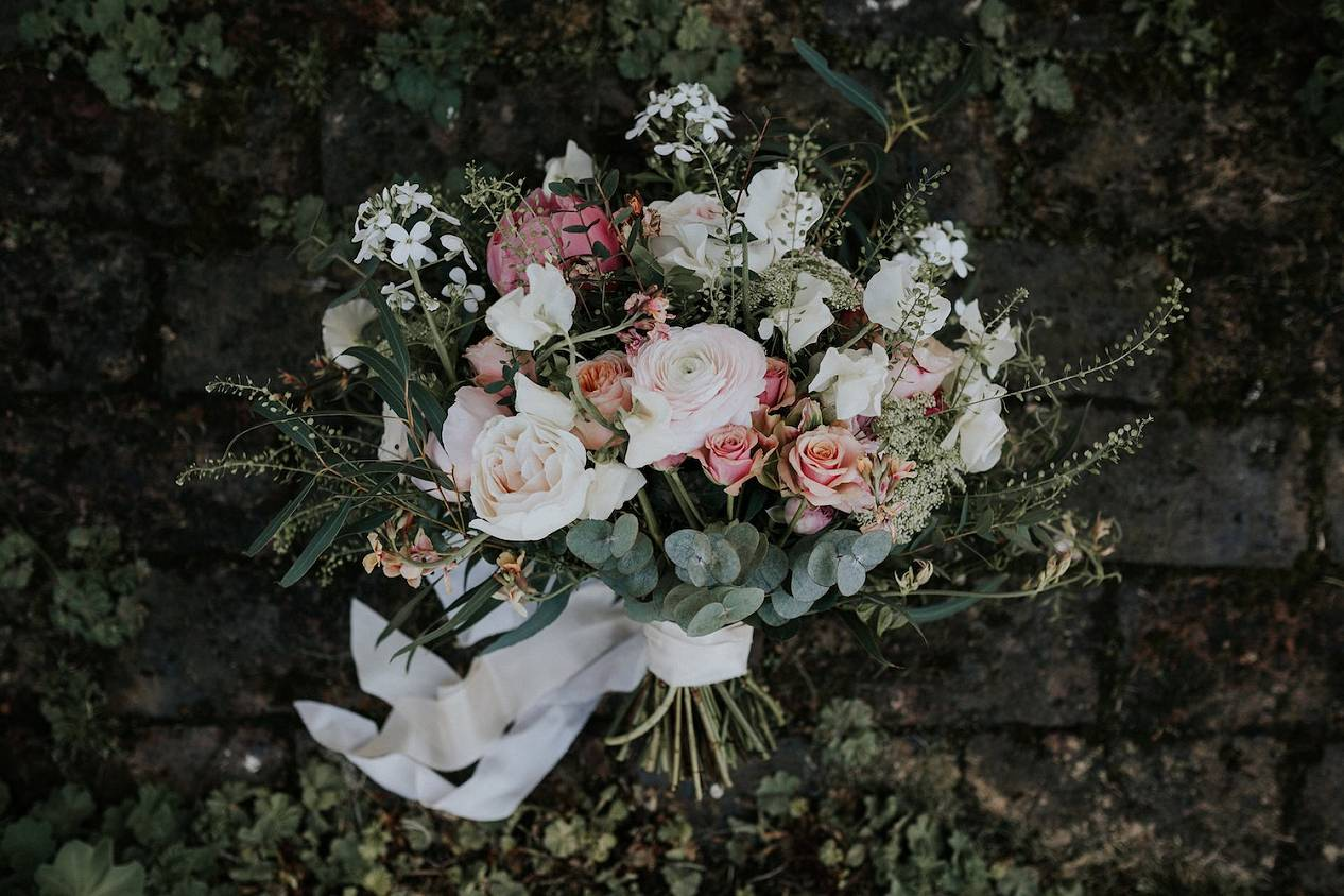 Pastel bridal bouquet with silk ribbon, pale pink roses, ranunculus, sweetpeas