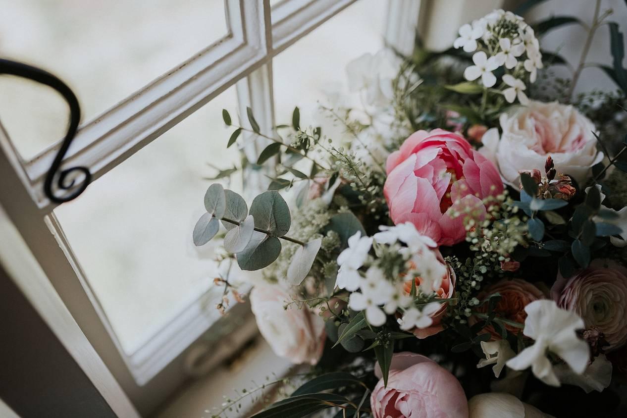 Peony, rose, sweetpea pastel pink bouquet in window