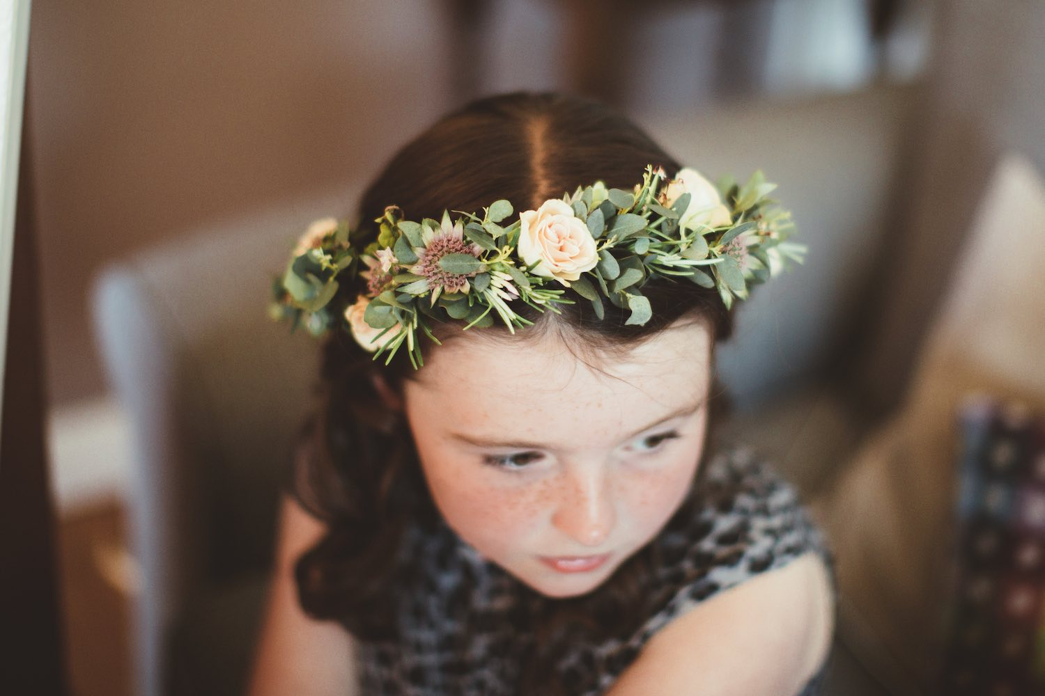 Flower girl wearing flower crown with pale pink and cream roses