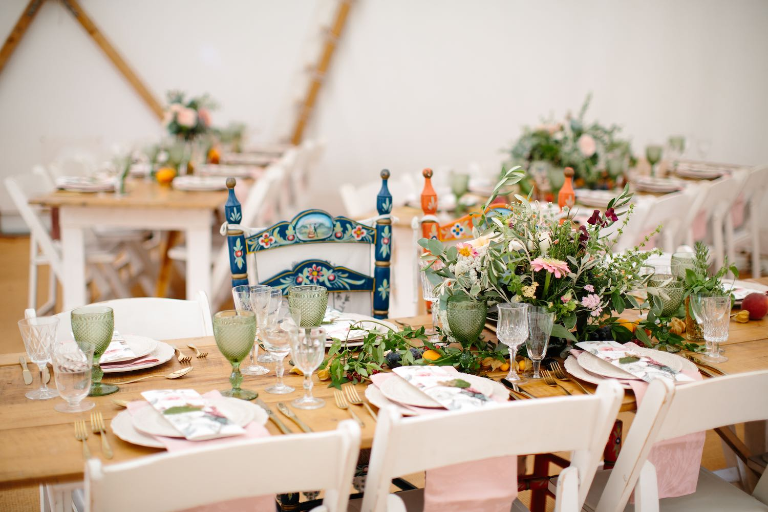 Richly laden wedding tables with flowers and fruit