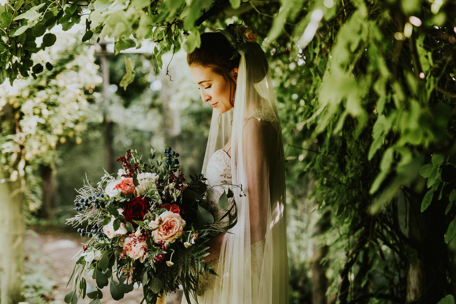 Woodland theme bride and bouquet under tree
