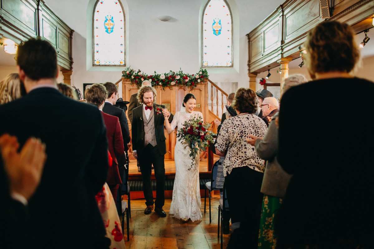 Church wedding ceremony couple walking down aisle