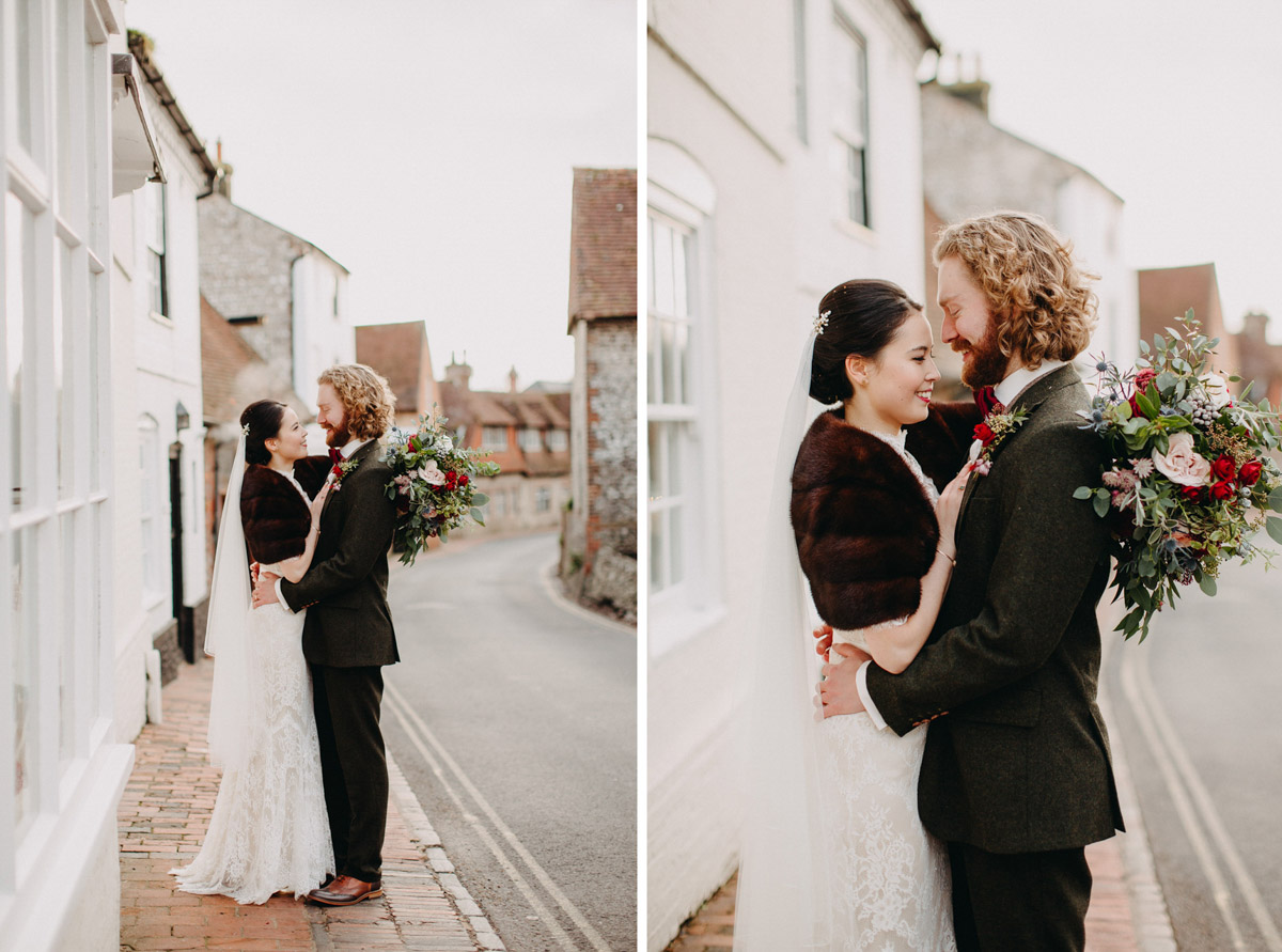 Winter wedding couple in Alfriston village with flowers