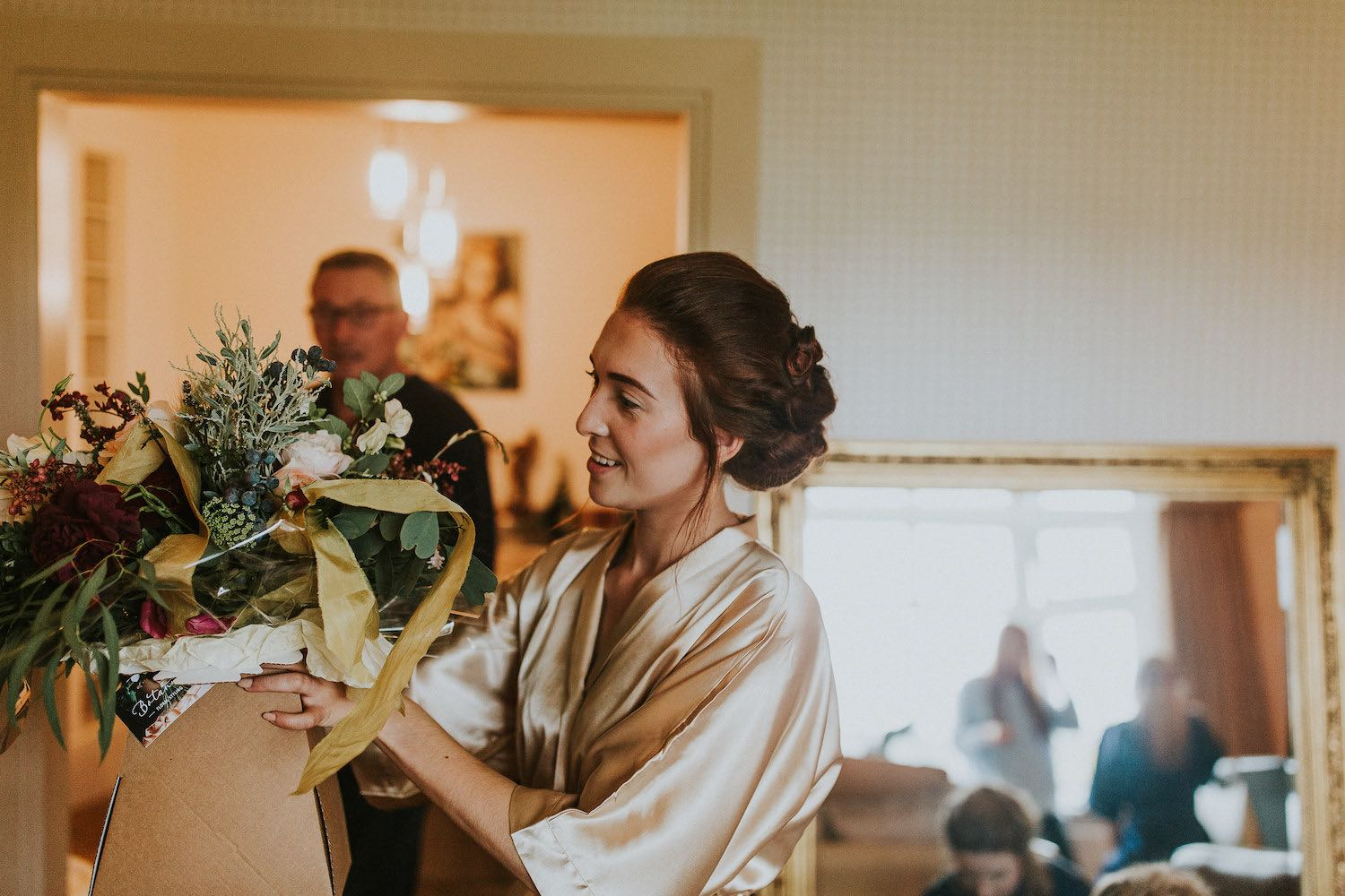 Brdie receiving flowers on morning of wedding