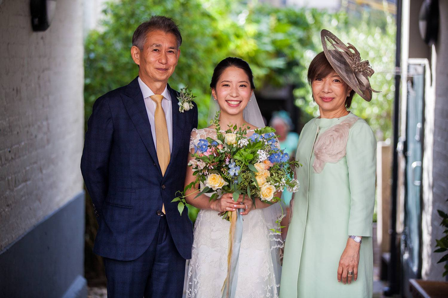 Japanese bride with parents and her flowers