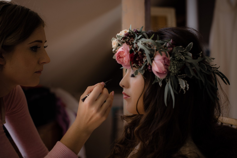 Bride with large rose flower crown having make up