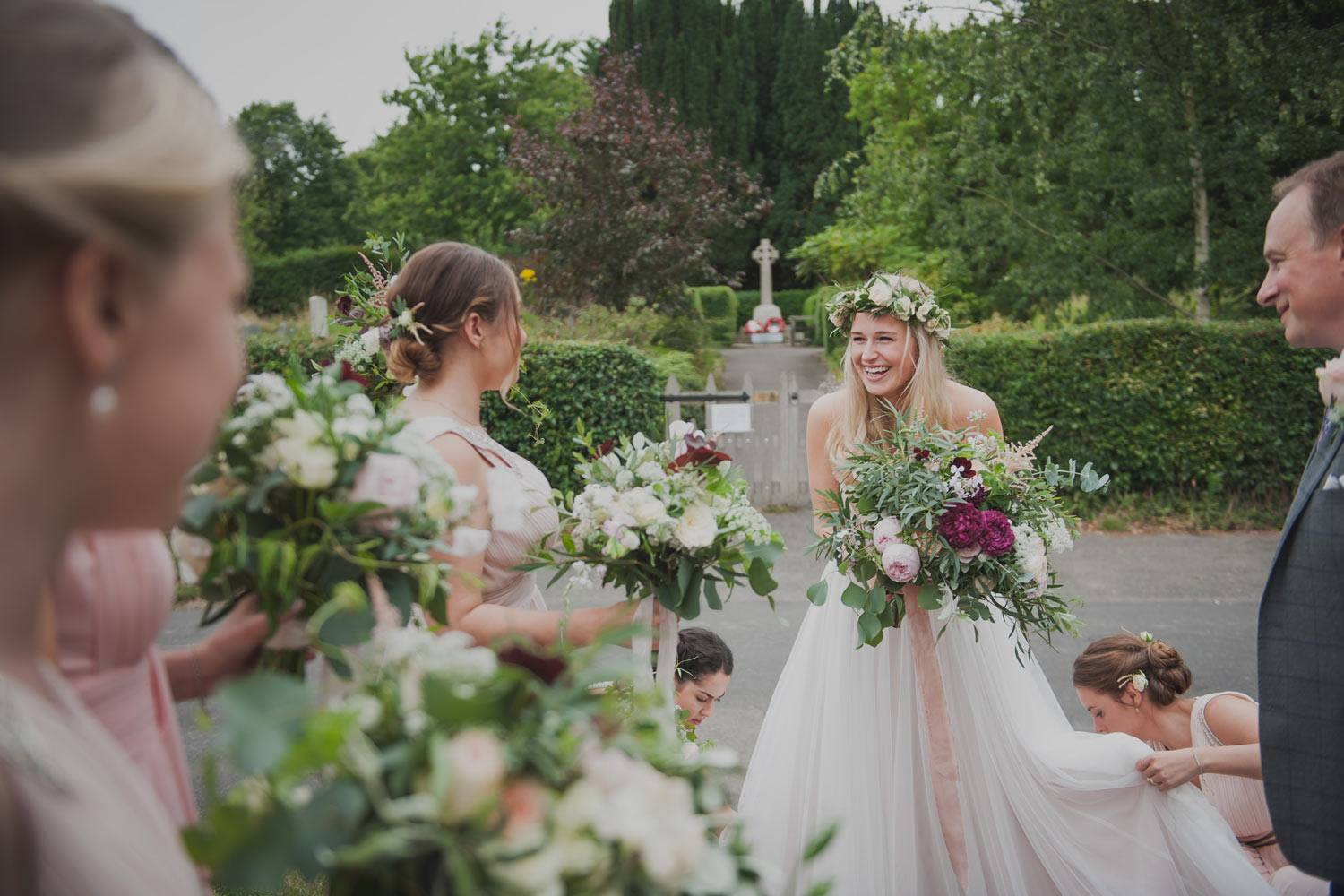 Bride and bridesmaids with garden rose natural bouquet and flower crown