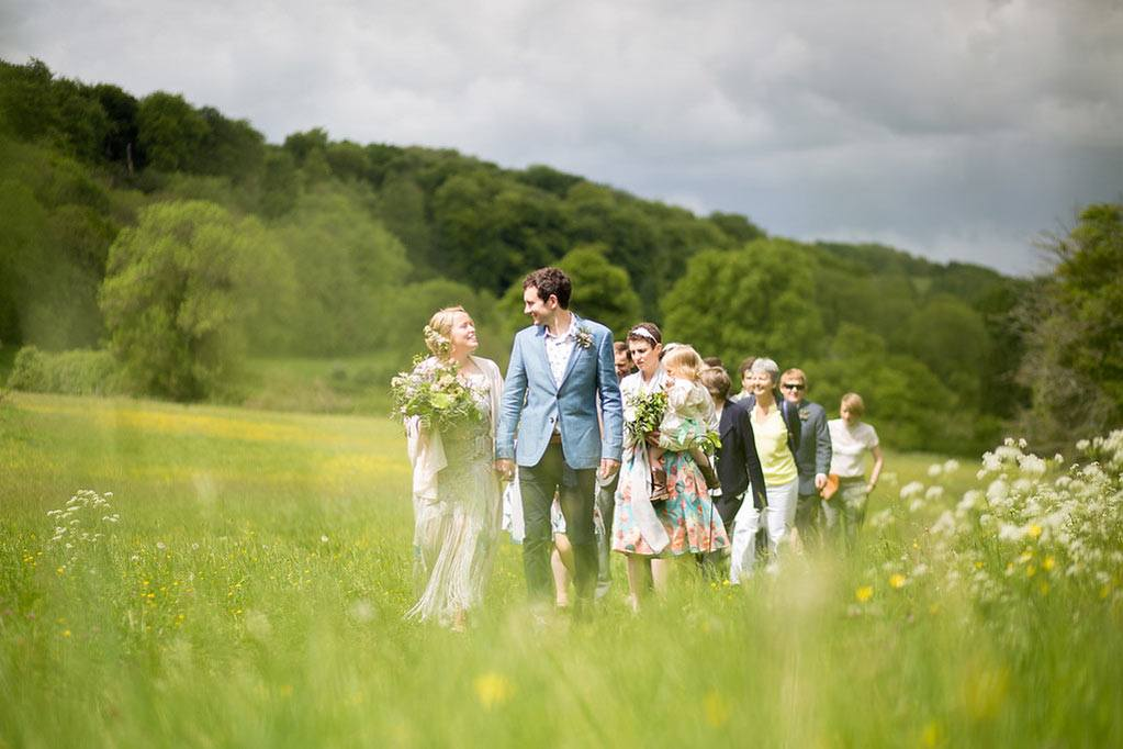 Wedding procession in spring meadow