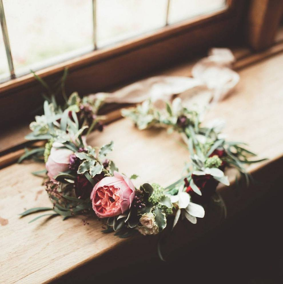 Bridal flower crown with coral rose and vintage flowers on window sill