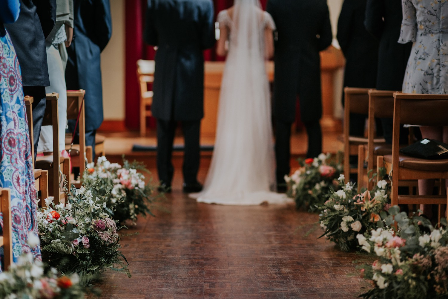 Church ceremony aisle flowers meadow style