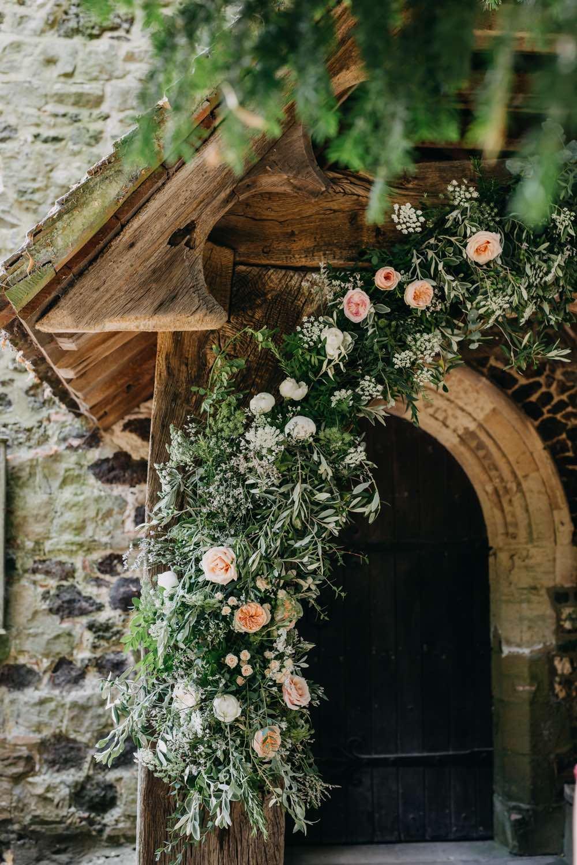 Flower arch on church entrance