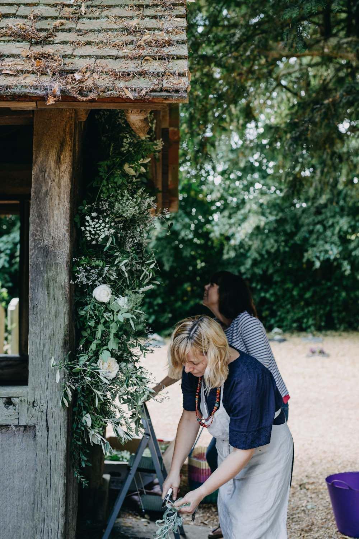 Florists making a church flower arch