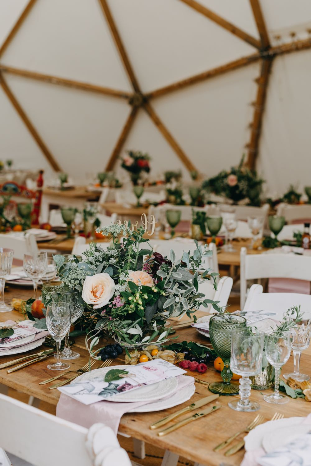 Marquee wedding tables laden with flowers and fruit