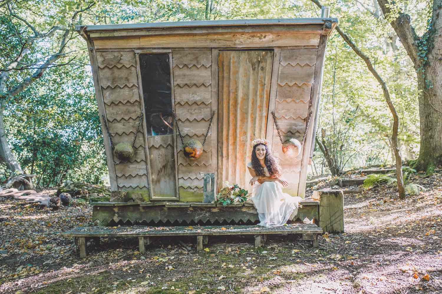 Woodland cabin and bride with flowers