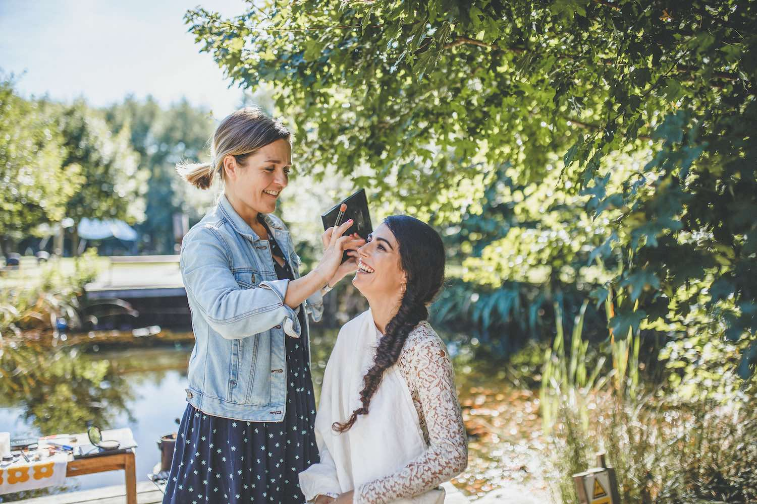 Bride having make up by the lake