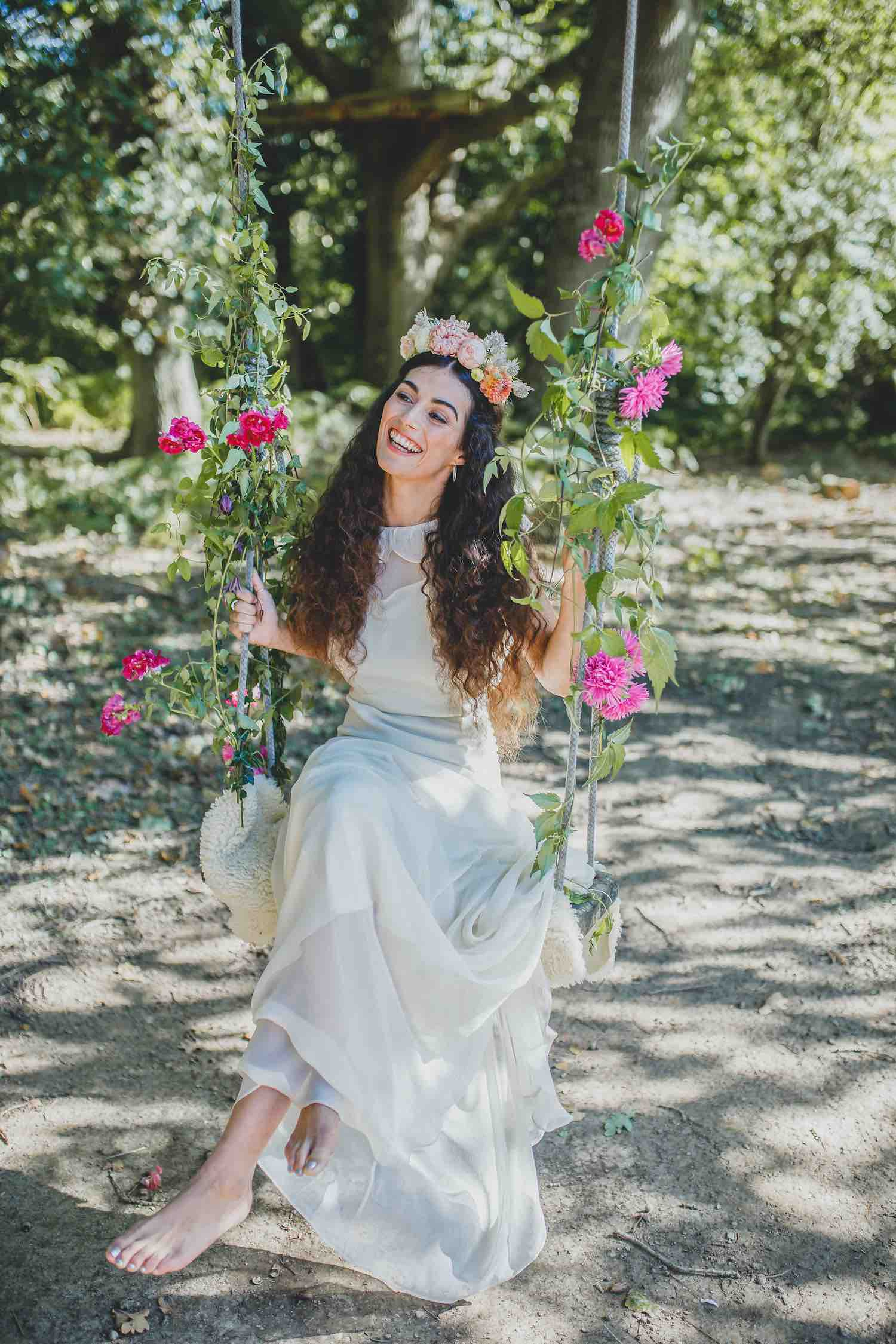 Bride on rope swing with flowers